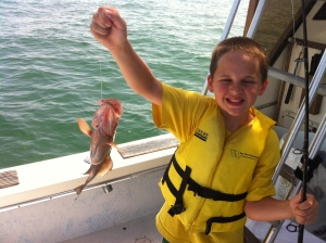 Brendan catches a red grouper off the coast of Marco Island.