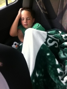 Sleeping in the car with my new Michigan State blanket.