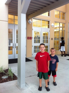 Me and my brother in front of our newly rebuilt school.