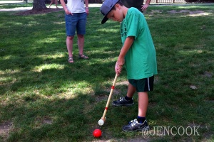 Playing croquet.