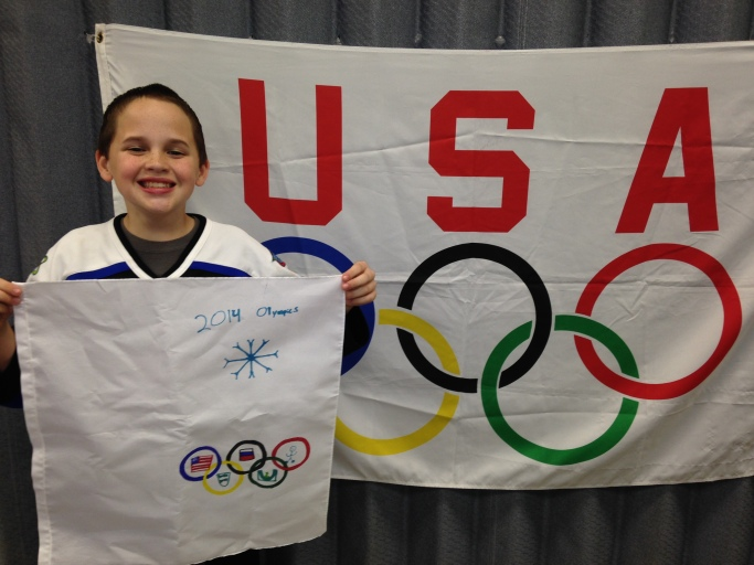 Brendan and his Olympic flag.