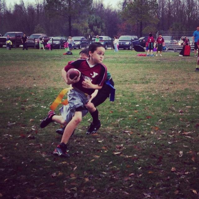 Brendan playing football.