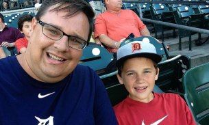 Me and my dad at the Detroit Tigers game.