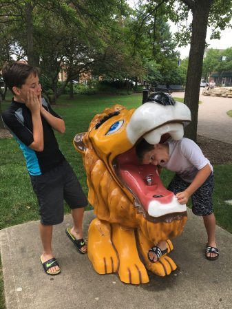 Visiting the lion water fountain at the Village Green in Northbrook.